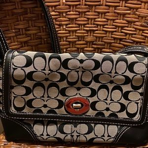 Coach purse saddle back style signature pattern